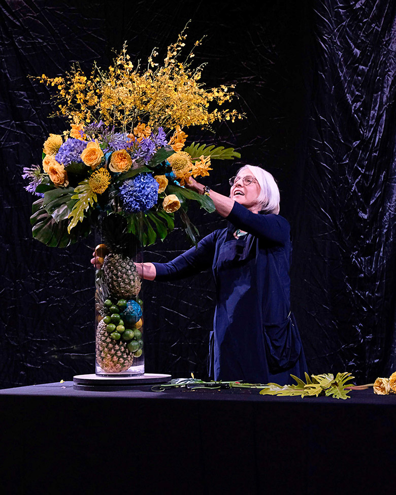 Jane Godshalk demonstrates how to set the table with flowers during a demonstration in Longwood's Ballroom