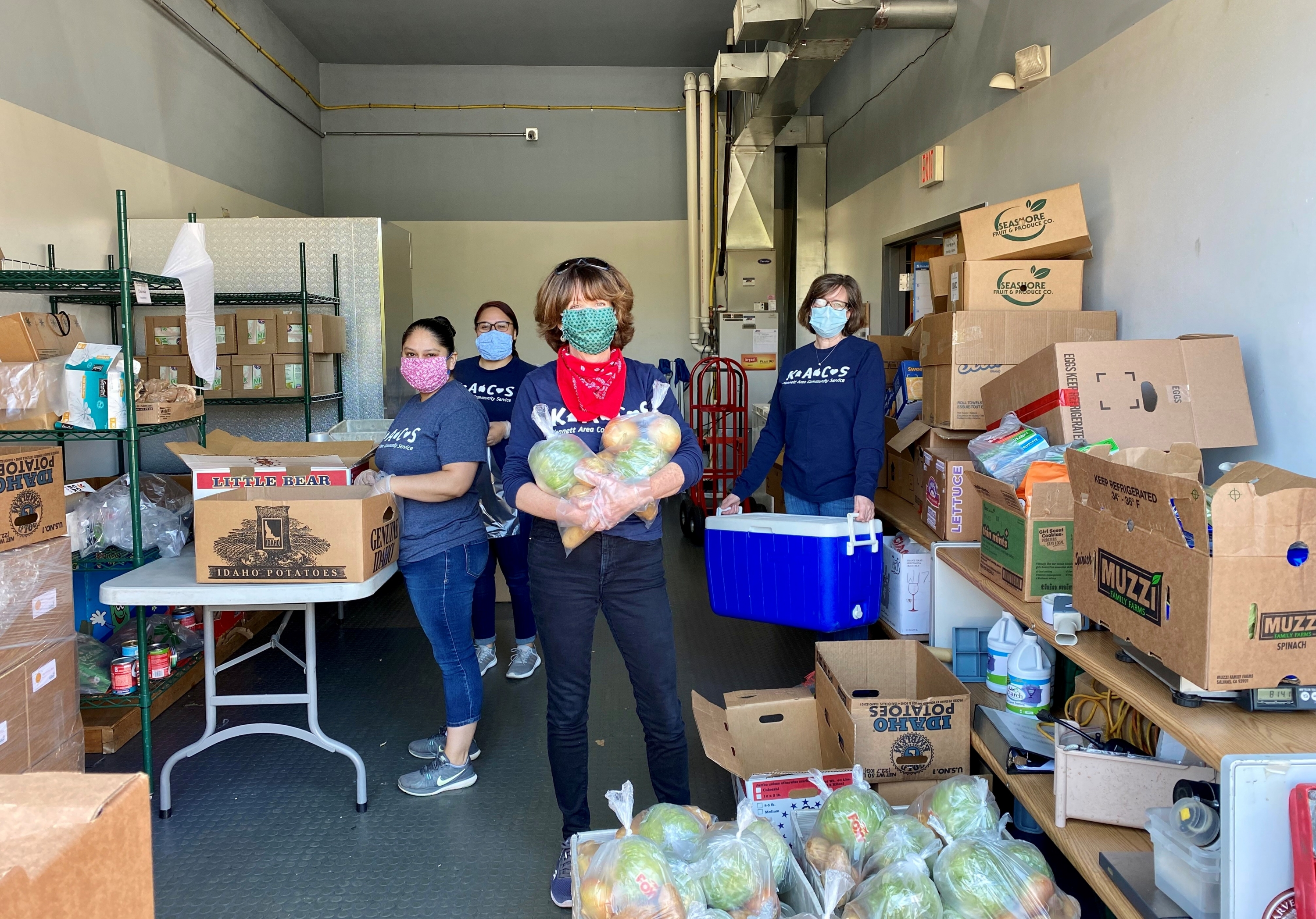 KACS volunteers prepping pre-packed boxes. Each box supplies about two weeks of food to those in need. Photo provided by Kennett Area Community Service.